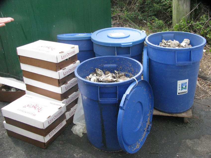 Oyster shells stored in 30-gallon bins